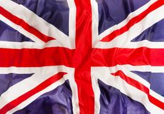 Zjednoczone Królestwo flaga państowowa z falowanie tkaniną obraz stock