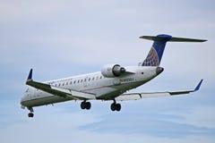 Zlany Ekspresowy bombardier CRJ-700 Wewnątrz Dla lądowania obrazy royalty free