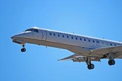 Zlany Ekspresowy Embraer ERJ-145LR początkowy W górę zdjęcia royalty free