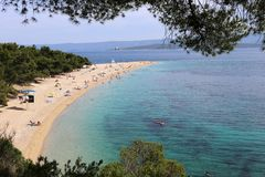 Zlatni Rat beach on isle Brac in Croatia stock images