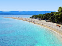 Zlatni Rat (Golden Cape) beach in Croatia. Zlatni Rat (Golden Cape) is a popular beach in the Town Bol which is on the south of the island of Brac in the Split Royalty Free Stock Photos