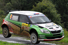 ZLIN, CZECH REP. - AUGUST 28 : Driver Kopecky J. And co driver Stary P.in Skoda Fabia S2000 at speed stage no.4 during Barum Czech Rally August 28, 2010 in Stock Images