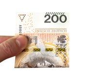 zloty bankbiljet 200 in een hand van een jonge mens Sluit omhoog stock afbeeldingen