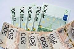 Zloty, euro y dólar polacos Fotos de archivo
