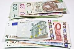 Zloty polaco de la moneda y el euro fotografía de archivo