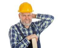 Zmęczony męski inżynier trzyma lath - odosobniony tło zdjęcie royalty free