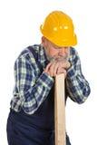 Zmęczony męski inżynier trzyma lath - odosobniony tło obraz royalty free