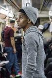 Zmęczony, młody amerykanina afrykańskiego pochodzenia mężczyzna, jedzie NYC metro Obraz Royalty Free