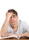 Zmęczony uczeń z książki Fotografia Stock