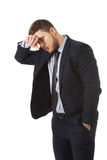 Zmartwiony biznesmen dotyka jego czoło zdjęcie stock