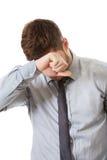 Zmartwiony biznesmen dotyka jego czoło zdjęcia stock