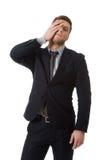 Zmartwiony biznesmen dotyka jego czoło fotografia stock