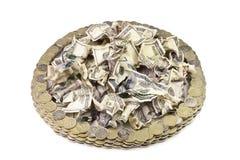 Zmięty dolar i rosjanin monety w postaci okręgu Obraz Royalty Free