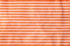Zmięty papier z pomarańczowymi lampasami obraz stock