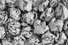 Zmięty papierowy piłki tło Zdjęcia Stock
