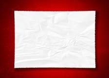 Zmięty papier na czerwieni Zdjęcie Stock