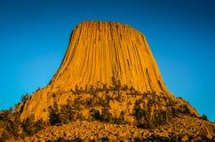 Zmierzch łuna na diabłach Góruje Krajowego zabytek - Wyoming Zdjęcia Stock