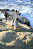 Zmierzch Ludzie na plaży zdjęcie royalty free
