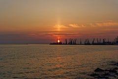 Zmierzch w Berdyansk portu morskiego Azov Handlowym morzu Obraz Royalty Free