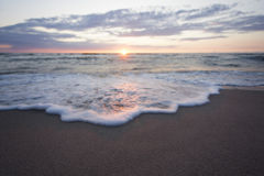 Zmierzchu morza plaża Obrazy Royalty Free