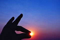 Zmierzchu nieba i sylwetki ręki ikona Zdjęcia Royalty Free