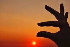 Zmierzchu nieba i sylwetki ręki ikona Zdjęcia Stock