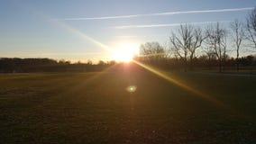 Zmierzchu wschód słońca boisk do piłki nożnej park obraz stock