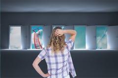Zmieszana kobieta patrzeje strzałkowatą kształt drabinę przez okno Obrazy Royalty Free