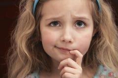 Zmieszana mała dziewczynka Obrazy Royalty Free