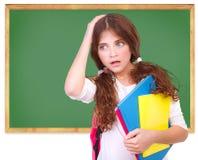Zmieszana szkolna dziewczyna Obrazy Stock
