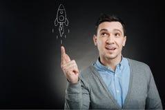 Zmieszany mężczyzna wszczyna rakietę Obraz Royalty Free