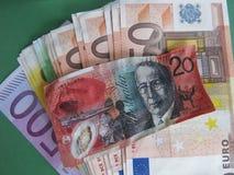 Zmniejszający się dolar australijski i euro Fotografia Royalty Free