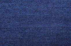 Zmrok - niebiescy dżinsy jako tło Obraz Royalty Free
