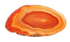 Zmrok - pomarańczowy agat odizolowywający na bielu Fotografia Stock