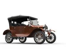 Zmrok - pomarańczowy oldtimer samochód Obrazy Stock