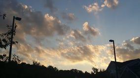 Zmroku i światła chmury Zdjęcia Royalty Free