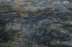 Zmroku kamienny tło z pęknięciami Obrazy Royalty Free