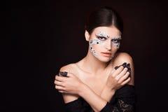 Zmysłowa kobieta z kreatywnie twarzy sztuką Fotografia Stock