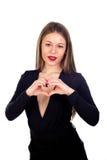 Zmysłowa piękna kobieta robi sercu z ona rękom Obrazy Royalty Free