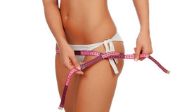 Zmysłowy żeński ciało z bikini i taśmy miarą Zdjęcia Stock