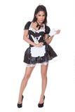 Zmysłowa kobieta w skimpy gosposia mundurze Zdjęcia Royalty Free