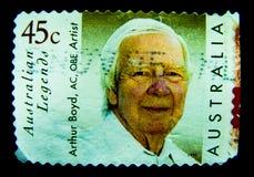 Znaczek drukujący w Australia pokazuje wizerunek Australijski legenda artysty Arthur Boyd AC, OBE na wartości przy 45 centem obrazy royalty free