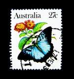 Znaczek drukujący w Australia pokazuje wizerunek Ulysses motyl na wartości przy 27 centem Zdjęcia Stock