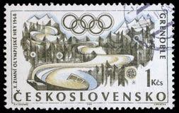 Znaczek drukujący w Czechoslovakia pokazuje zim olimpiady w Grenoble, około 1968 fotografia stock