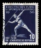 Znaczek drukujący w GDR pokazuje darda miotacze zdjęcia royalty free