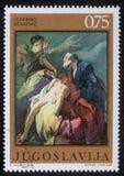 Znaczek drukujący w Jugosławia pokazuje Abraham Poświęcać Isaac Fotografia Stock