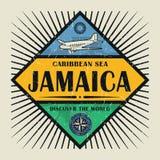 Znaczka lub rocznika emblemata tekst Jamajka, Odkrywa świat royalty ilustracja