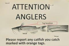 Znak dla wędkarza rybaka który łapie suma fotografia stock