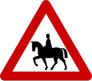 Znak ostrzegawczy z końskimi jeźdzami na drodze Zdjęcia Royalty Free