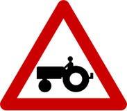 Znak ostrzegawczy z rolnym ciągnikiem Fotografia Stock